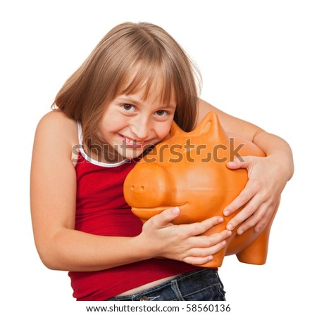 Girl loving her big fat piggy bank full with money - stock photo