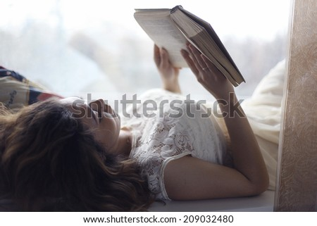 girl lying and reading - stock photo