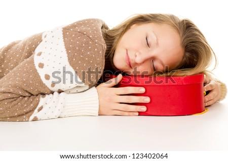 girl lying and sleeping on the gift box - stock photo