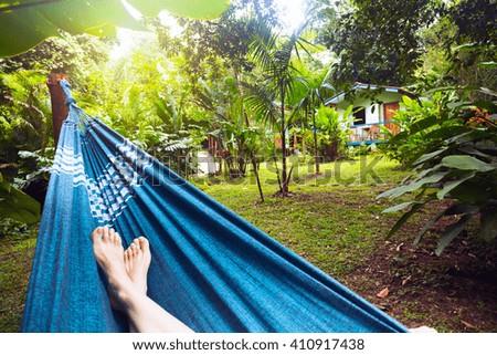 girl lying in a hammock in the tropical jungles of Brazil. Brasil - stock photo