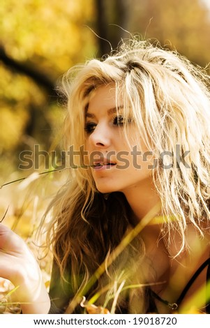 Girl lying in the front with blade of grass