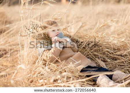 Girl lying in the grass in spring - stock photo