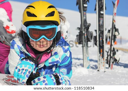 Girl lying in the snow - stock photo