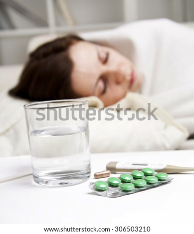 girl lying near sick medicines