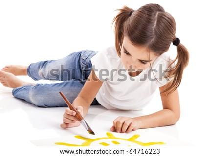 Girl lying on floor and painting a happy sun