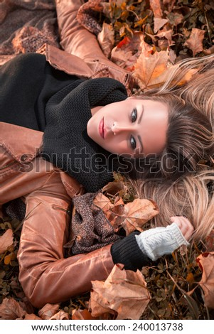 Girl lying on the autumn leaves