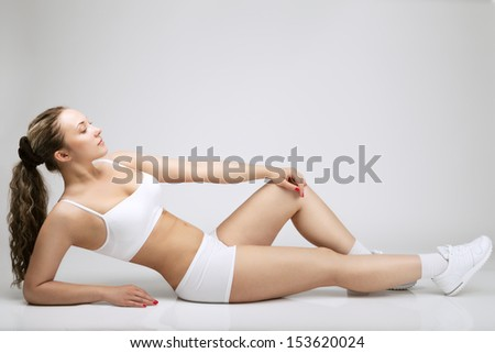 girl lying on the floor and doing exercises