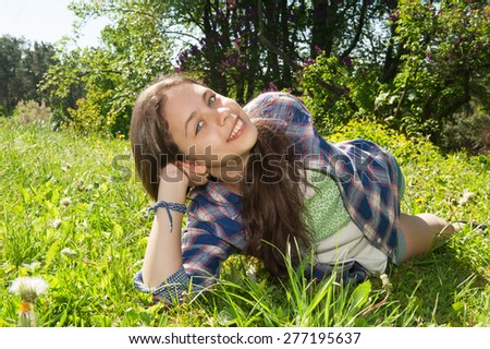 Girl lying on the grass in the park