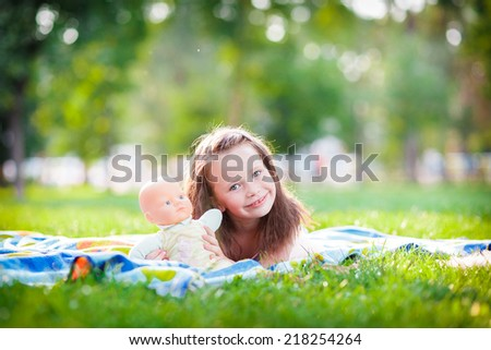 Girl lying on the grass on a blanket