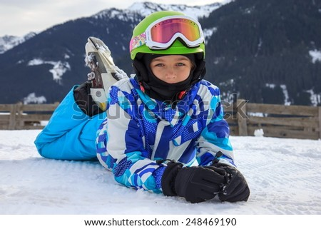 Girl lying on the snow - stock photo