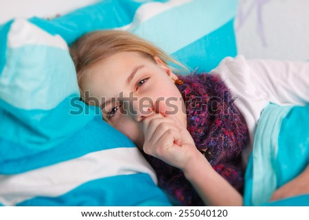 girl lying sick in bed - stock photo