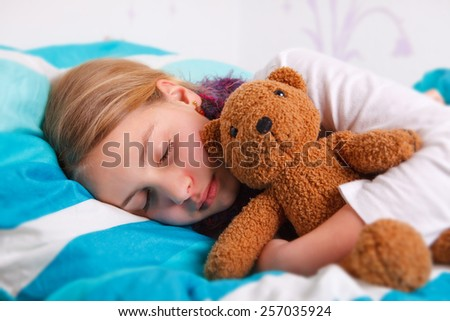 girl lying sick in bed and sleeping - stock photo