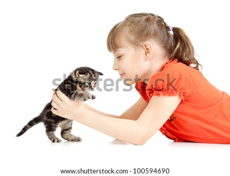 Girl lying with British kitten isolated on white