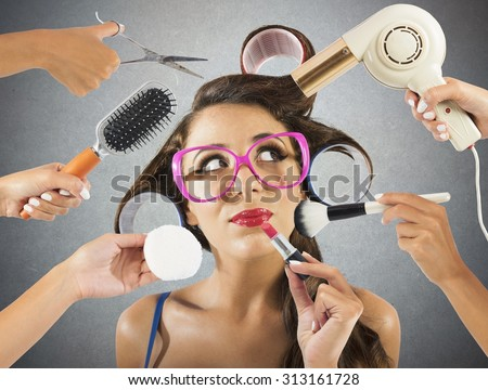 Girl made up and coiffed by many hands - stock photo
