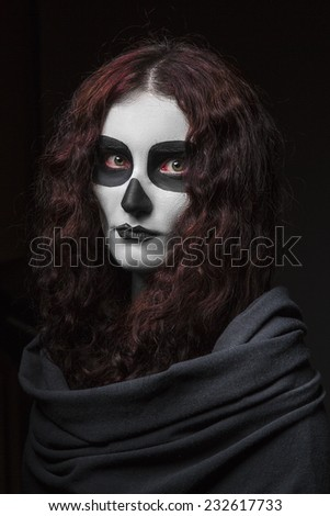 Girl make up a skull