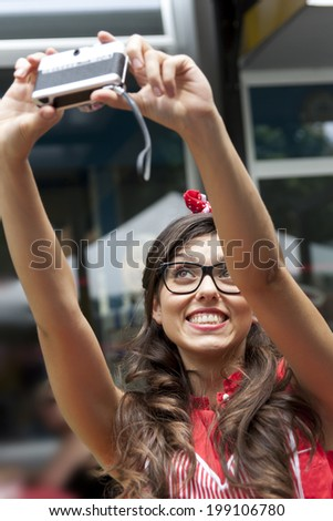 girl makes a selfie with a vintage camera - stock photo