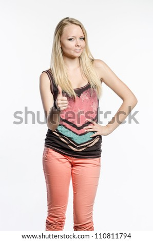 Girl makes a sign with her thumb - stock photo