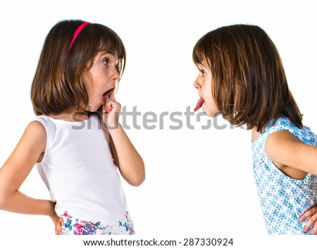 Girl making a joke at her sister - stock photo