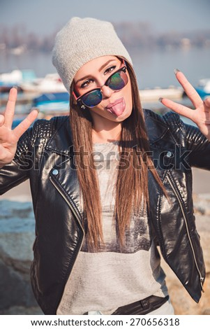 Girl making funny expression - stock photo