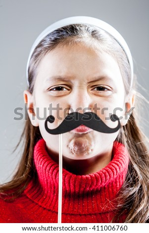 girl making grimaces and funny faces with carton disguises
