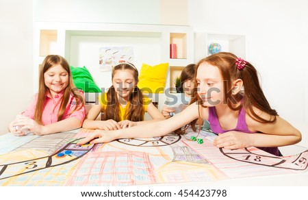 Girl making her move playing the tabletop game