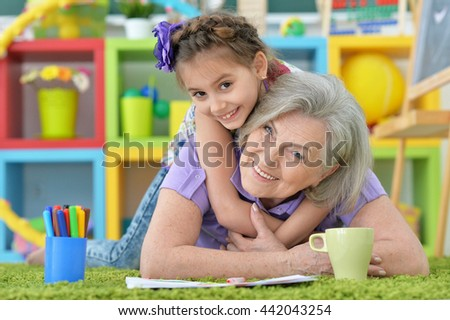 girl making homework with granny