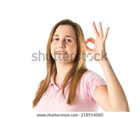 Girl making Ok sign over white background