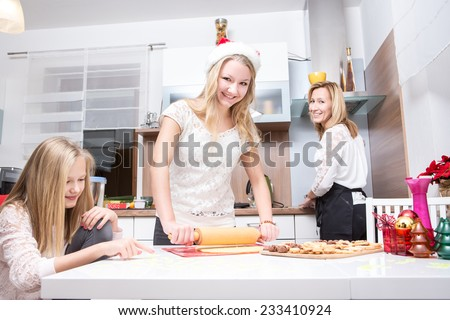 girl making xmas cookies at home with her family
