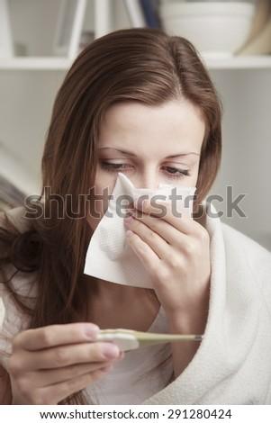 Girl mereet temperature at cold - stock photo
