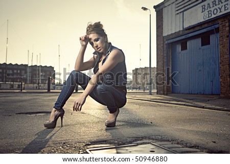 girl modeling clothes at an urban street location - stock photo