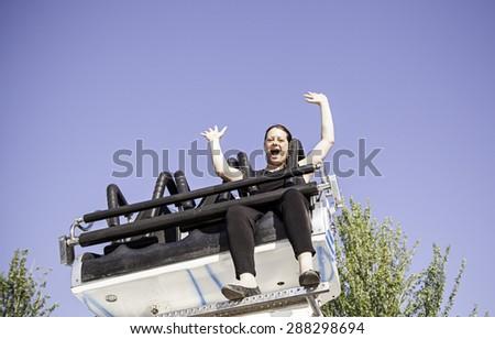 Girl mounted fairground, parties and fun - stock photo