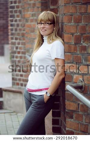 girl near a brick wall - stock photo