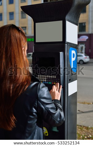 Girl near the ATM paid parking
