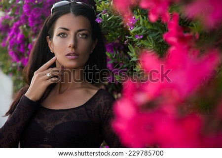 girl near the bush with flowers - stock photo