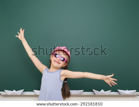 girl near the school board - stock photo