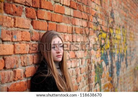 Girl near the wall - stock photo