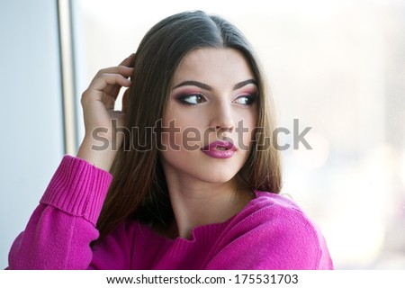 girl near window thinking about something
