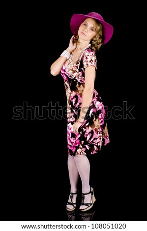 Girl-next-door beauty in colorful spring outfit and hat. - stock photo