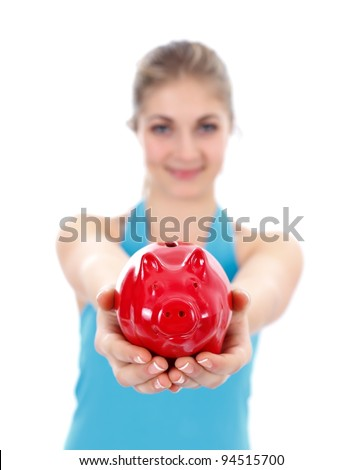 Girl offering a red piggy bank to us, white background - stock photo