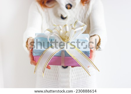 Girl offering gifts, closeup - stock photo