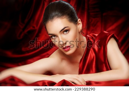 girl on a background of red cloth - stock photo