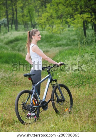 Girl on a bicycle in a forest