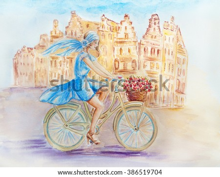 Girl on a bicycle in the old town - stock photo