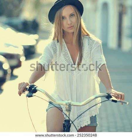 Girl on a bike - stock photo