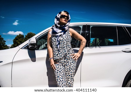 girl on a car background - stock photo