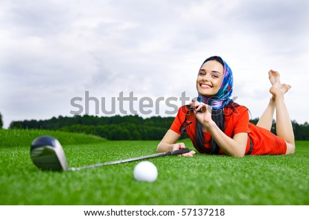 girl on a golf a field - stock photo