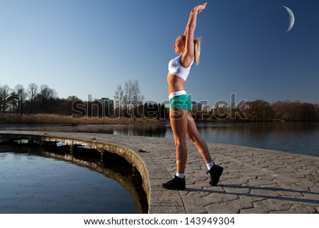 girl on a morning jog in the summer outdoors - stock photo
