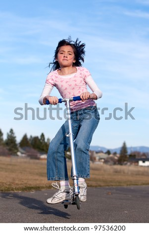 Girl on a scooter. - stock photo