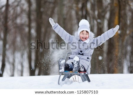 Girl on a sled - stock photo