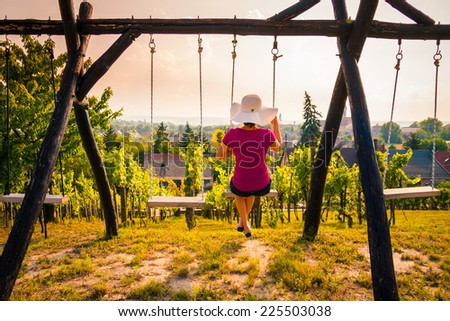 Girl on a swing - stock photo